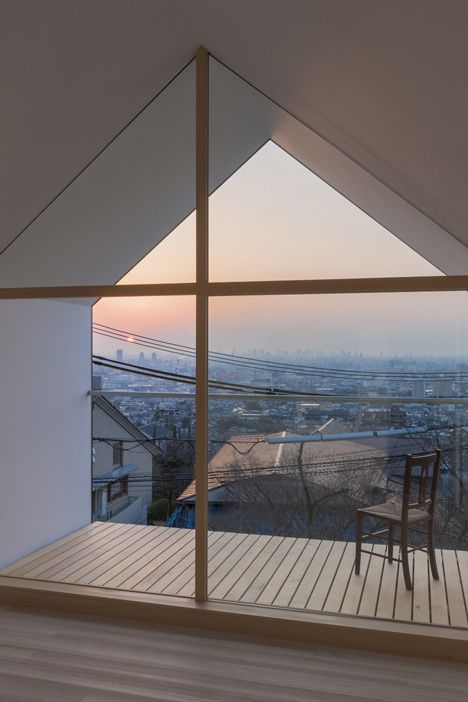 House in Ishikiri by Tato Architects | Gabled roof and deck