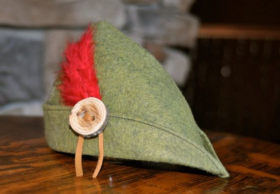 Peter Pan, Robin Hood or Jack and the bean stock could have worn this nice green felt hat. The attached button is handmade and rubbed with lemon oil.