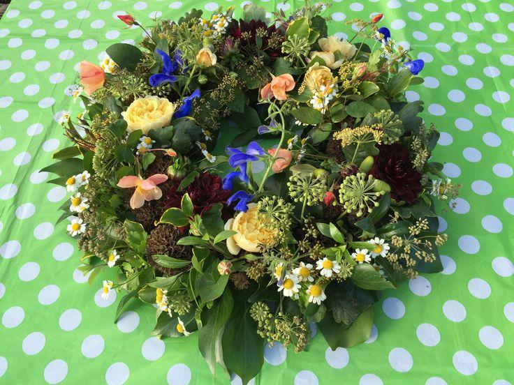British flowers #Homegrown #Fresh from our cottage garden #Wreath ring #Funeral flowers/wedding table arrangements #David Austin roses #Blue salvias #Acorns #Oak leaves #Deep burgundy Dahlias #Feverfew #Mixed foliages. All enquiries email:- vick@bloominglovelyflowersandplants.co.uk