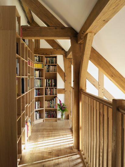 Landing with bookshelves and extensive book collection. Oakwrights #oak #landing #library