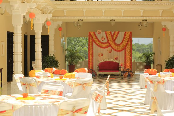 Indian wedding mehendi decor. Backdrop for bride. Floral print. Marigold flowers.
