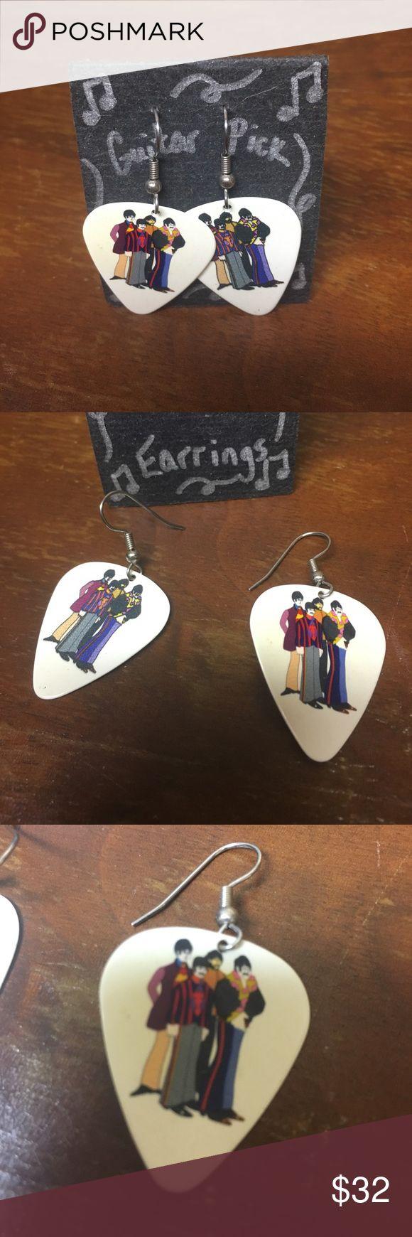 Guitar Pick Earring. Beatles Super awesome Beatles Band Guitar Pick earrings. Hand made. Hanging / dangling earrings. Open to offers Jewelry Earrings