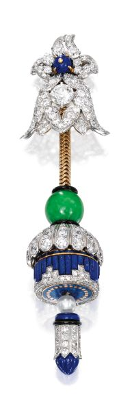 An Art Deco 'Stalactite' lapel-watch, by Cartier. The floral top centred by an old European-cut diamond, suspending a pendant which opens to reveal a watch dial, topped by a jadeite bead, accented by a pearl, decorated throughout with lapis lazuli segments and highlighted with black enamel, set throughout with old European and single-cut diamonds, the dial signed Cartier, numbered, circa 1925. #ArtDeco #Cartier #watch