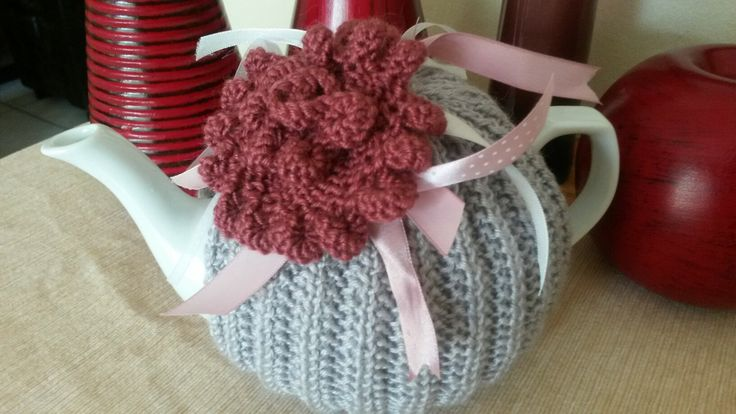Pink knitted rose and ribbon tea cosie