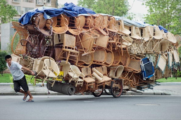 A man pulls a cart loaded with chairs in Shanghai on September 1, 2010. Chinese shares were up 0.58 percent in early trade tracking Wall Street's rally overnight after encouraging US and Chinese manufacturing data renewed economic recovery hopes, dealers said.