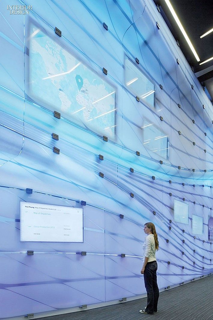Belzberg Architects made an interactive media wall the dominant feature of the lobby at the McKinnon Center for Global Affairs, a renovated building at Occidental College in Los Angeles. #design #interiordesign #interiordesignmagazine