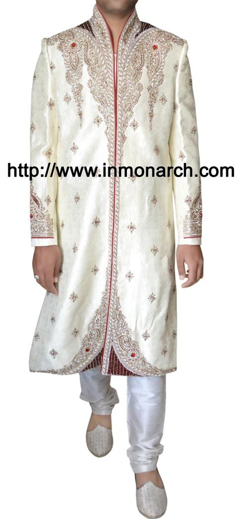 Attractive designer work wedding mens cream color brocade sherwani. Embroidered elegantly on neck, collar, front till bottom and sleeve cuffs. It has white churidar pyjama at bottom. Sold as a
