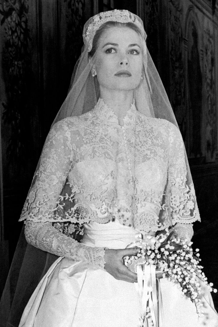 American actress Grace Kelly set the standard for royal weddings in her 1956 marriage to Prince Rainer III of Monaco. Wedding Dress Cost, Wedding Gowns With Sleeves, Long Sleeve Wedding, Wedding Dresses, Bride Dresses, Wedding Flowers, Grace Kelly Wedding, Kate Middleton Wedding Dress, How To Be Graceful