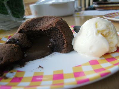 Molten Chocolate Lava Cake- very gooey if you follow the directions .  I recommend cooking for 10-15 mins more if you don't want it too gooey. They also firm up a little after cooling.  Bake to your desired doneness.