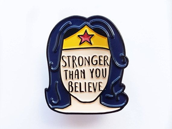 This enamel pin of our original illustration features the mantra Stronger Than You Believe, sending out positive vibes to all the wonder women out there. Life can be tough sometimes, this empowering message will remind you that youve got what it takes. Prove the haters wrong. You are stronger than you believe, so go show the world! Pin it to your lapel, bag or anywhere you have space for it. In creating this design I drew inspiration from both classic Wonder Woman comic books and the truly…
