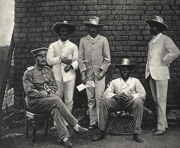 File:Theodor Lutwein & Samuel Maharero (1895).png Theodor Leutwein (seated left), Zacharias Zeraua (2nd from left) and Manasseh Tyiseseta (seated, fourth from left), in 1895.