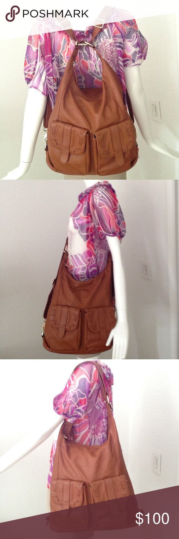"""Epiphanie leather bag 13.5""""x4.5""""x13.75"""".       3-in-1 Bag from Epiphanie can be worn over your shoulder, cross-body, or as a backpack without removing any straps.  Please see picture for condition. No major defects.     Has marks on hard wear and top back as Pictured.     No Trade!! Epiphanie Bags"""