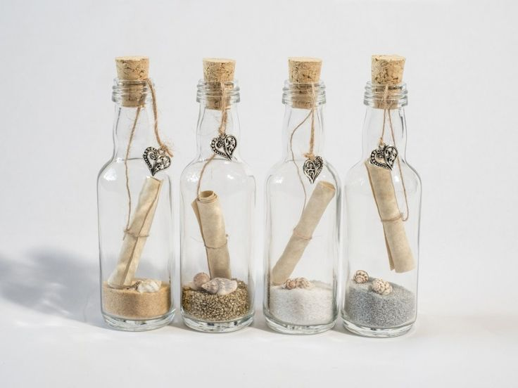Small message in a bottle style wedding invitations and save the dates. Message in a bottle wedding favours.  #wedding