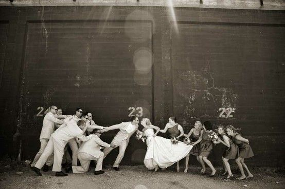Bride and groom tug of war! Such a cute picture
