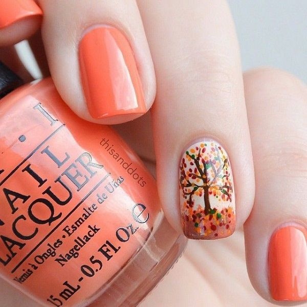 Warm colored and pretty leaf nail art design. The combination of melon and brown nail polish give out a homey vibe with the addition of red, green and orange for the leaves.