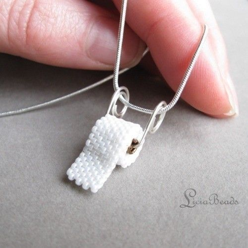 Tiny seed beads woven into a little toilet paper roll pendant.  Start some smiles! $45
