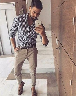 A white and black gingham button-down shirt and beige chinos is a versatile comb…