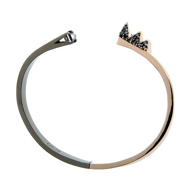 BANGLE IRREVERENT Rosé and gunmetal-plated sterling silver 925 with a hyaline quartz stone and a pavé of 24 black zircons stones €1000. This piece comes in a designer-stamped box.