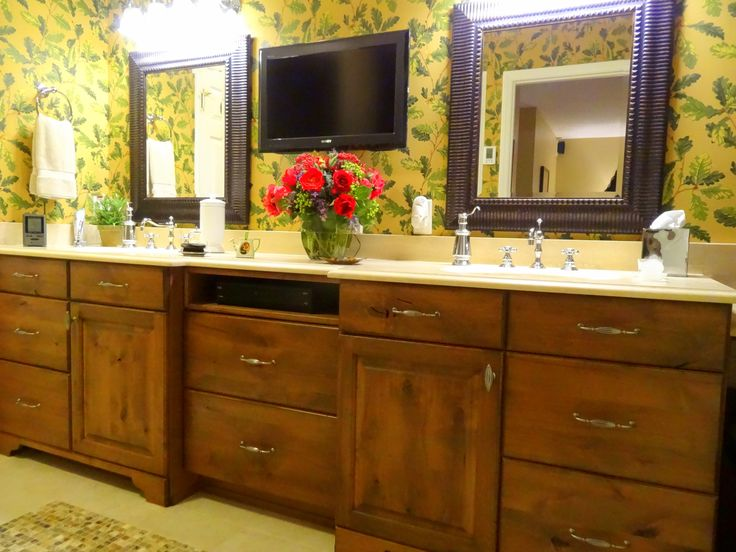 Tropical Master Bath by High Country Cabinets of Banner Elk, NC. Features his and hers vanities, media storage, and custom vanity table.
