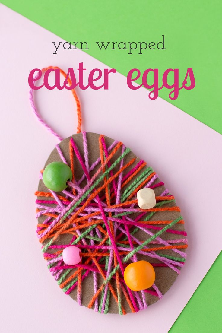 Just in time for Easter, kids can learn how to make a colorful Yarn Wrapped Easter Egg Craft at school or home. Such a pretty fine-motor craft for kids! via @https://www.pinterest.com/fireflymudpie/