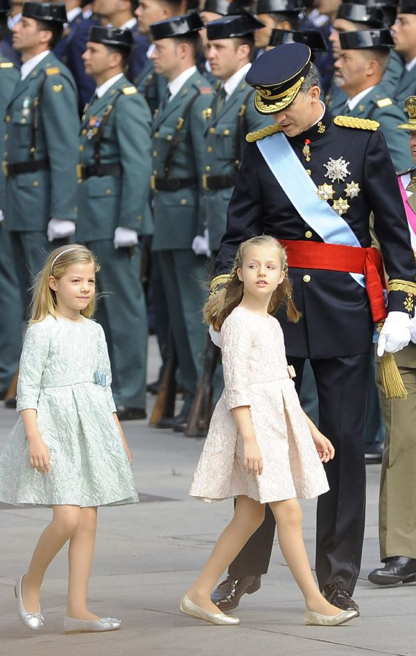 King Felipe VI with daughters Crown Princess Leonor and Infanta Sofia June 19, 2014