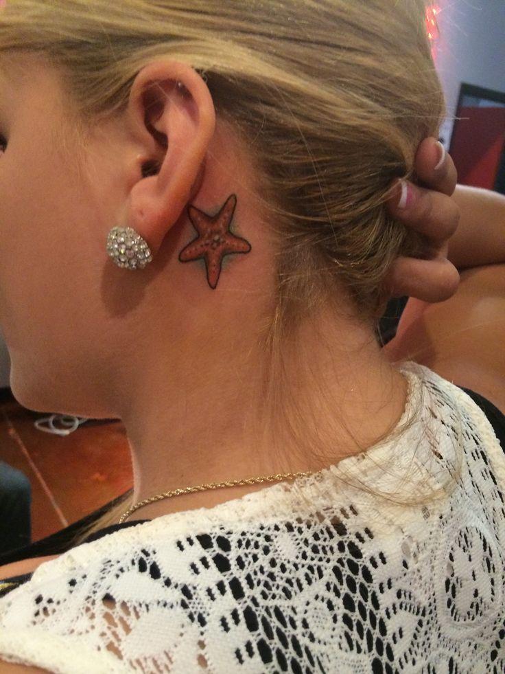 Starfish tattoo behind ear