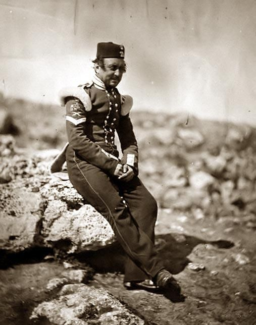 Full-length portrait of a Sergeant of the British Light Infantry facing slightly right. It was taken during the Crimean War.
