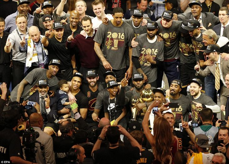 The 2016 NBA Champions pose for a team photo with the NBA Finals Championship Trophy after defeating the Golden State Warriors in NBA Finals game seven at Oracle Arena in Oakland, California