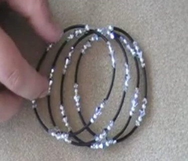 Memory Wire Cover-Up Bracelet Tutorial - uses round screw crimp beads at ends of wire.   There's a video tutorial, although I haven't watched it.