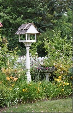 A bird feeder becomes a focal point in the garden.