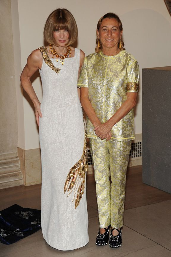 Inspired Conversation: Miucca Prada and Anna Wintour in Prada-designed Schiaparelli inspired lobster dress.