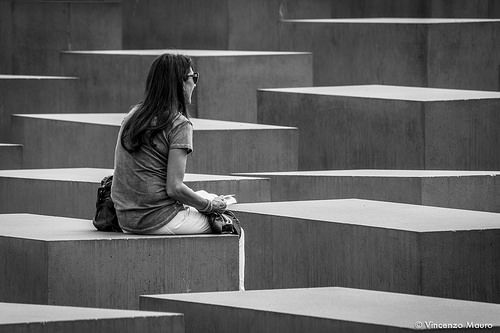 Woman reading in the Memorial to the Murdered Jews of Europe. (Berlin 2014)