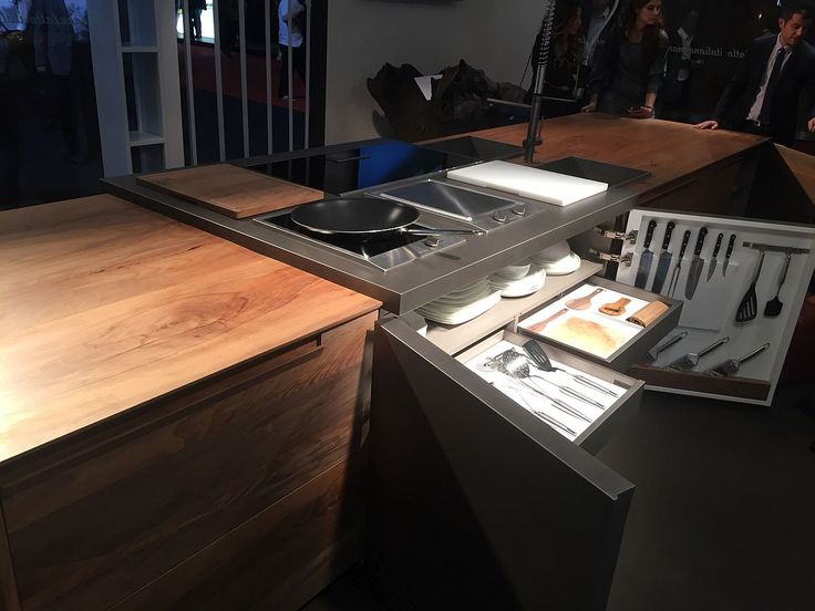 Making most of the kitchen island with smart storage units and additional drawers