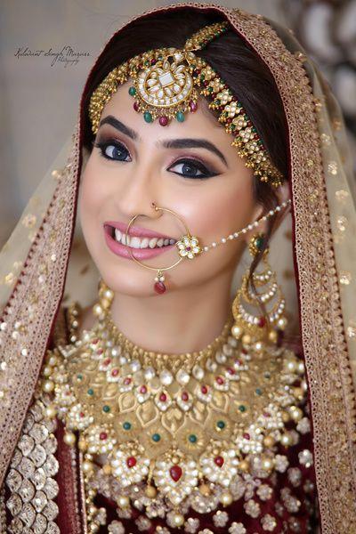 Indian Wedding Jewelry - Gold, Ruby and Emerald Jewelry Set   WedMeGood   Gold, Ruby and Emerald Necklace with Maatha Patti, Pearl Nath #wedmegood #indianbride #indianjewelry #jewelry #gold #maathapatti #necklace #diamond #ruby #emerald