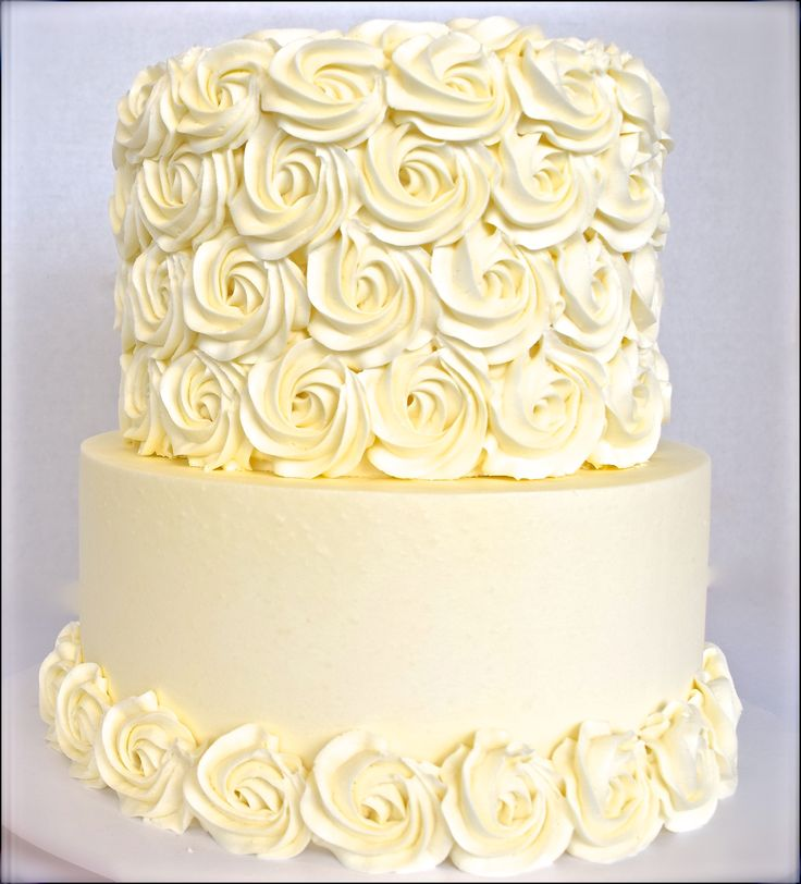 White rosette cake, two tiers and a rosette border. Love this cake!