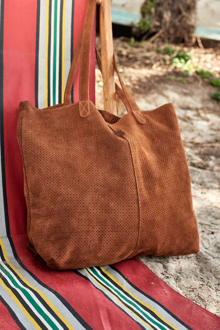 Effortless style starts here. Introducing the TOMS Cinnamon Suede Cosmopolitan Tote Bag.