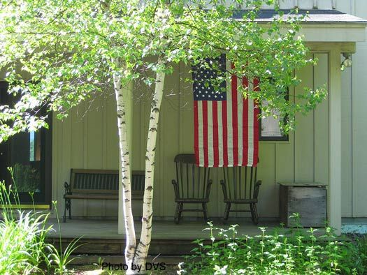 A simple country porch full of patriotism.