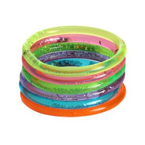 Glitter water bracelets!! I wore more than 10 of these my sophomore year of high school. I even took one off and wrote in the circles in the yearbook.