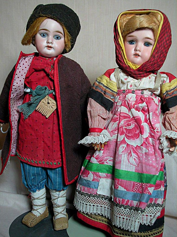 There are two dolls  Both are about 15 inches tall.  They are German dolls,  the boy has a label inside of his coat that has some Russian marks and
