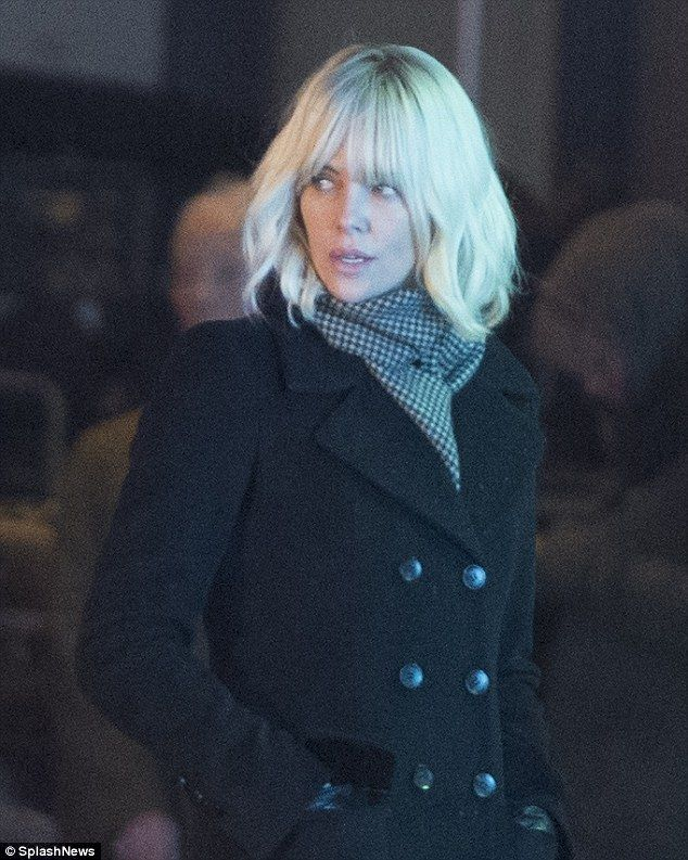 Do blondes have more fun? The Mad Max: Fury Road star sported a platinum blonde wig which was feathered and full-fringe in style as she got to work on set
