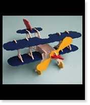 Transform a balsa  wood model plane  into something special  with the help of a few  Resene testpots.