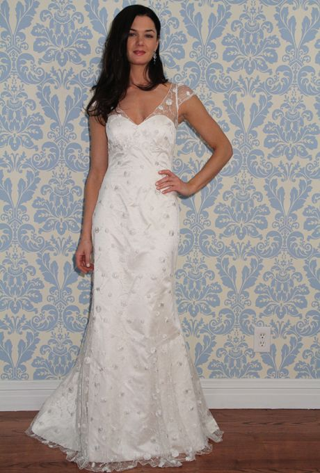 Brides.com: . Embroidered tulle sheath wedding dress with an illusion v-neckline and short sleeves, Modern Trousseau  See more Modern Trousseau wedding dresses in our gallery.