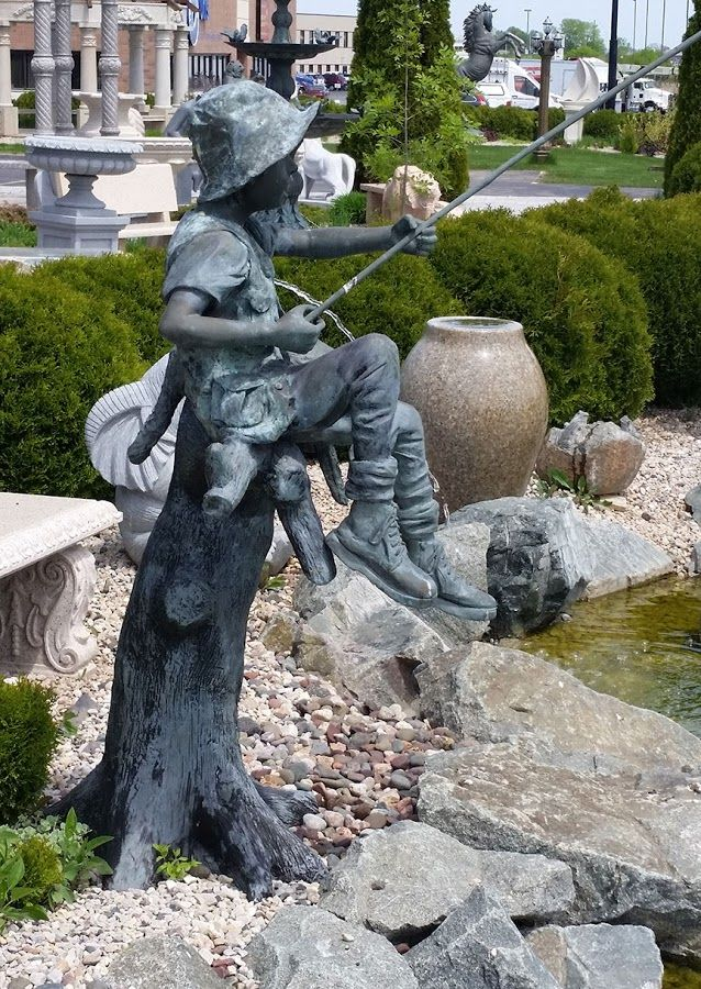 B Fisher Creations This bronze statue fea...