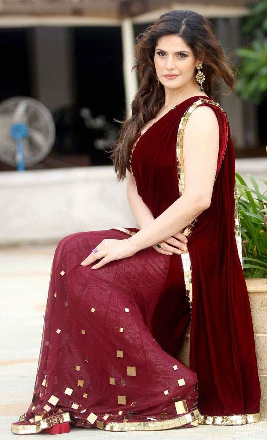Zarine khan in wine color saree.  For bollywood's latest fashion and trend update visit - http://www.ethnicoapp.com/tag/bollywood