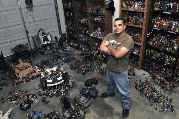 """Carlos Hernandez has thousands of action figures that he has collected over the years. They are stored on the floor, on shelves and hang from the ceiling of his garage."""