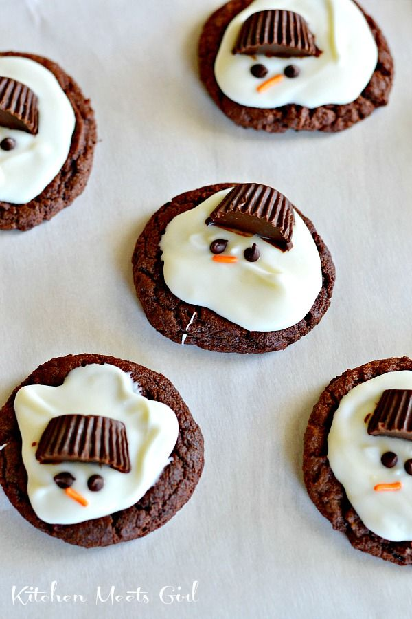 Melting Snowmen (Chocolate Mint) Cookies | Kitchen Meets Girl | A basic cake mix cookie recipe, some mint flavoring, and Candiquik to melt the snowmen. Pop on a (half) Reese's Peanut Butter cup for a hat, mini chocolate chips for eyes, and use an orange jimmy for the nose! Try them here.