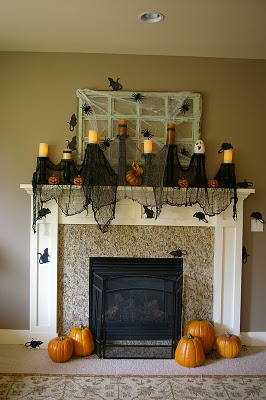 Great idea for the mantel using martha stewart rat diecuts for How to decorate your fireplace for halloween
