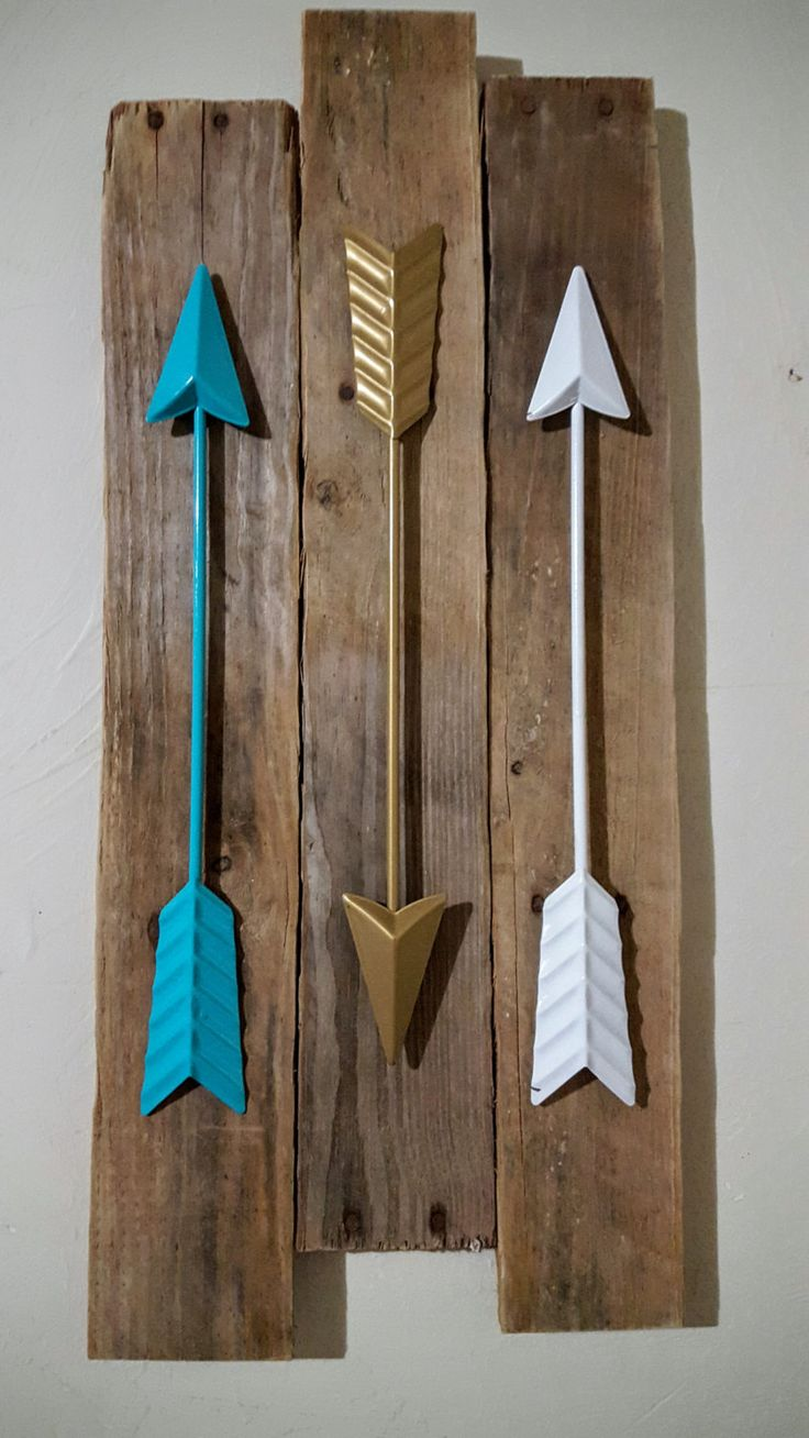 Love these arrows and colors on reclaimed wood by WorkinThePlank on Etsy