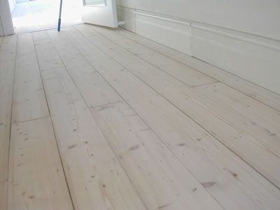 White lime wash on old pine floor