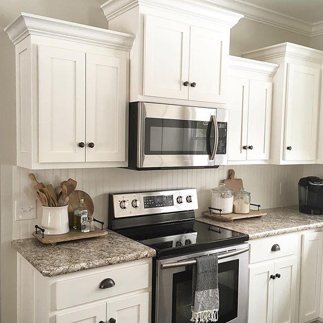 Kitchen Cupboard Top Decor: Countertops: Bianca Romana Cabinet Color: Benjamin Moore